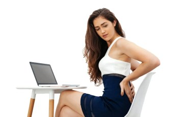 blog picture of young woman with back pain