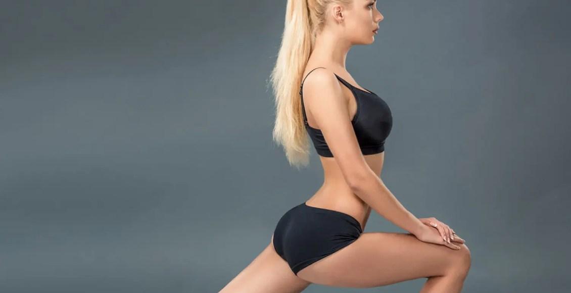 jovem mulher bonita em alongamento de desgaste físico