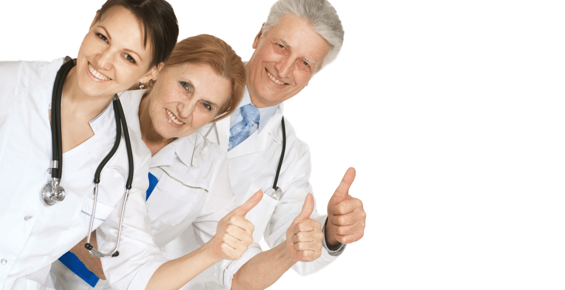 group of doctors standing thumbs up