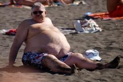 obesity man sits at beach el paso tx