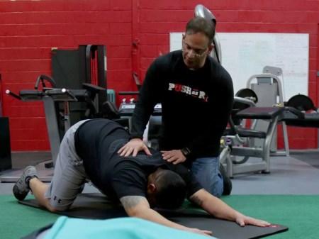 Dr Jimenez helping man stretch_preview
