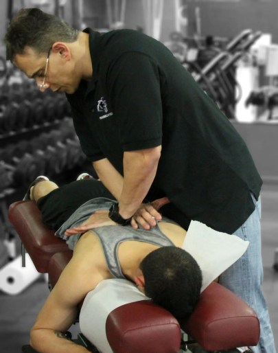 Dr Jimenez works on back treatment at Push crossfit competition   El Paso, TX Chiropractor