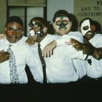 Members of a Drama Therapy Group at Second Genesis perform wearing half masks.