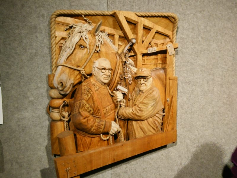 A carved, inlaid, and assembled three-dimensional image. What does it tell you about the person who made it? What if I revealed it's a self-portrait? What do you see then?