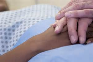 Holding sick person's hand