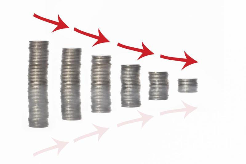 Stack of coins and red arrow with reflection on white background