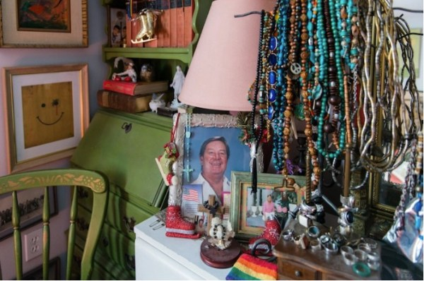 A photo of Dehag's partner sits on the dresser in his bedroom. Dehag moved into one of the apartments shortly after his partner passed away.