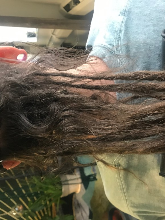 A before picture showing new growth and slight matting of my client's partial dreadlocks.