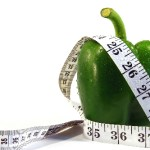 Green pepper wrapped in measurement tape
