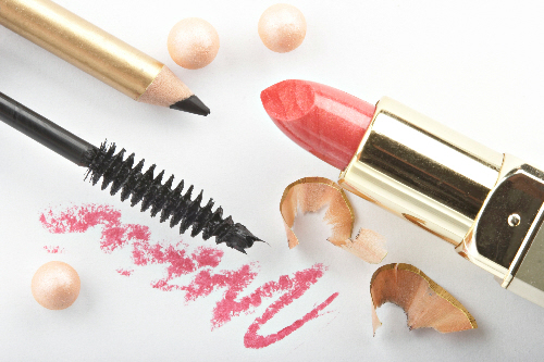 Still life with cosmetics on white background