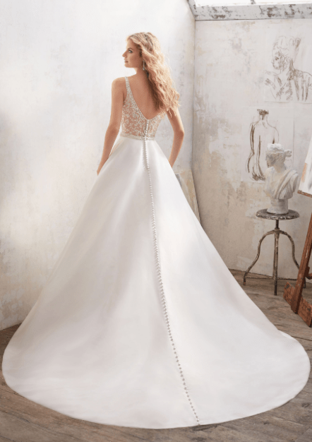 Maribella - Understated and Elegant, This Stunning Marcella Satin A-Line Bridal Gown Features a Crystal Beaded Sheer Back and Waistline. Covered Buttons Trim the Back and Train.