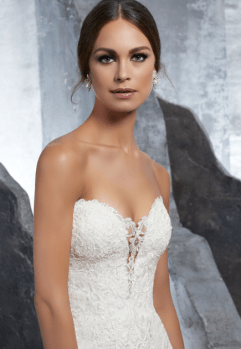 Kaitlyn - Romantic Frosted, Alençon Lace Mermaid Net Wedding Dress Accented in Appliqués and a Delicate Scalloped Hemline. An Exposed Boned Back Trimed in Covered Buttons Completes the Look.