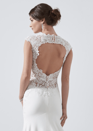 A decadent mermaid style, with an illusion neckline, illusion capped sleeves, illusion back and finished with a keyhole back detail. Zip back and buttons. Available in Ivory Only. Photographed in Ivory.