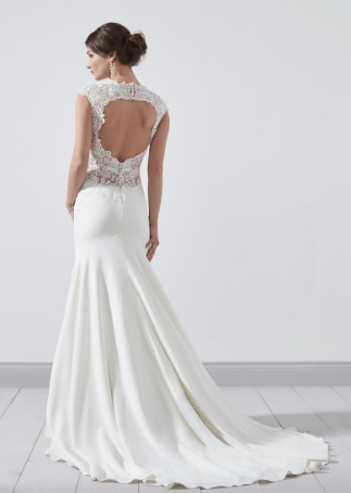 PC8352 A decadent mermaid style, with an illusion neckline, illusion capped sleeves, illusion back and finished with a keyhole back detail. Zip back and buttons. Available in Ivory Only. Photographed in Ivory.