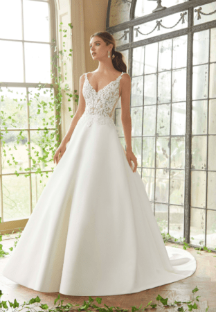 Petrova -Clear Crystal and Pearl Beaded, Embroidered Appliqués Over Chantilly Lace Bodice with Appliquéd Straps on a Full, Satin Ballgown with Pockets.