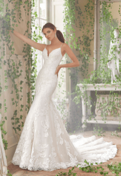 Peta - Frosted, Embroidered Lace Appliqués on a Fit and Flare, Tulle Gown with Long, Sheer Train with Scalloped Hemline, Accented with Crystal Beaded Straps and Sheer Back Detail.
