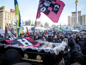 Mikhail Zhiznevsky's coffin is paraded through the protest, draped in flag of his paramilitary nazi group. Pic credit: Getty Images