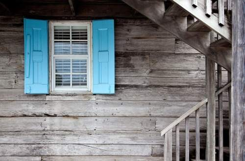 Grey house window blue shutters