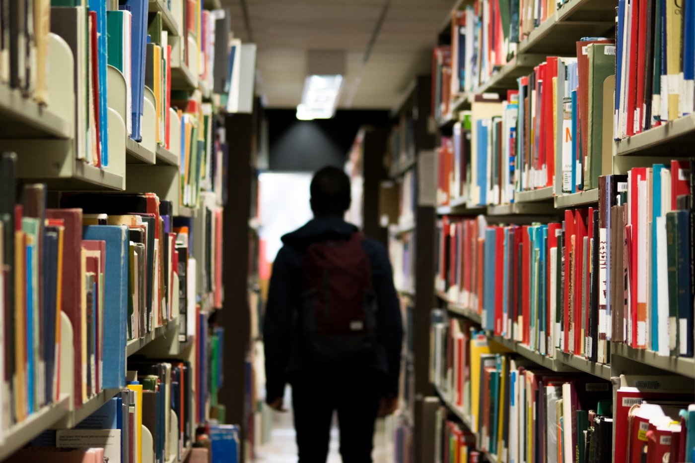 student studying in library books
