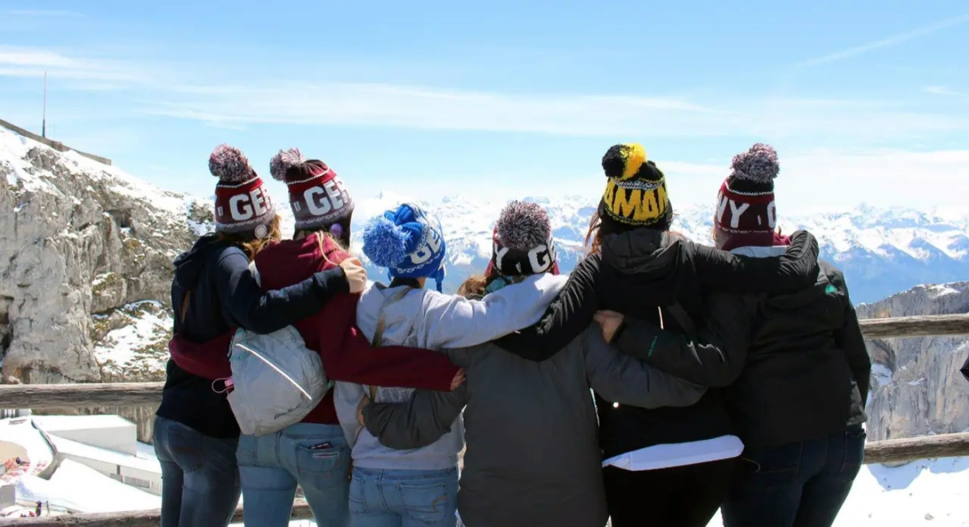group viewing mountains of the swiss alps