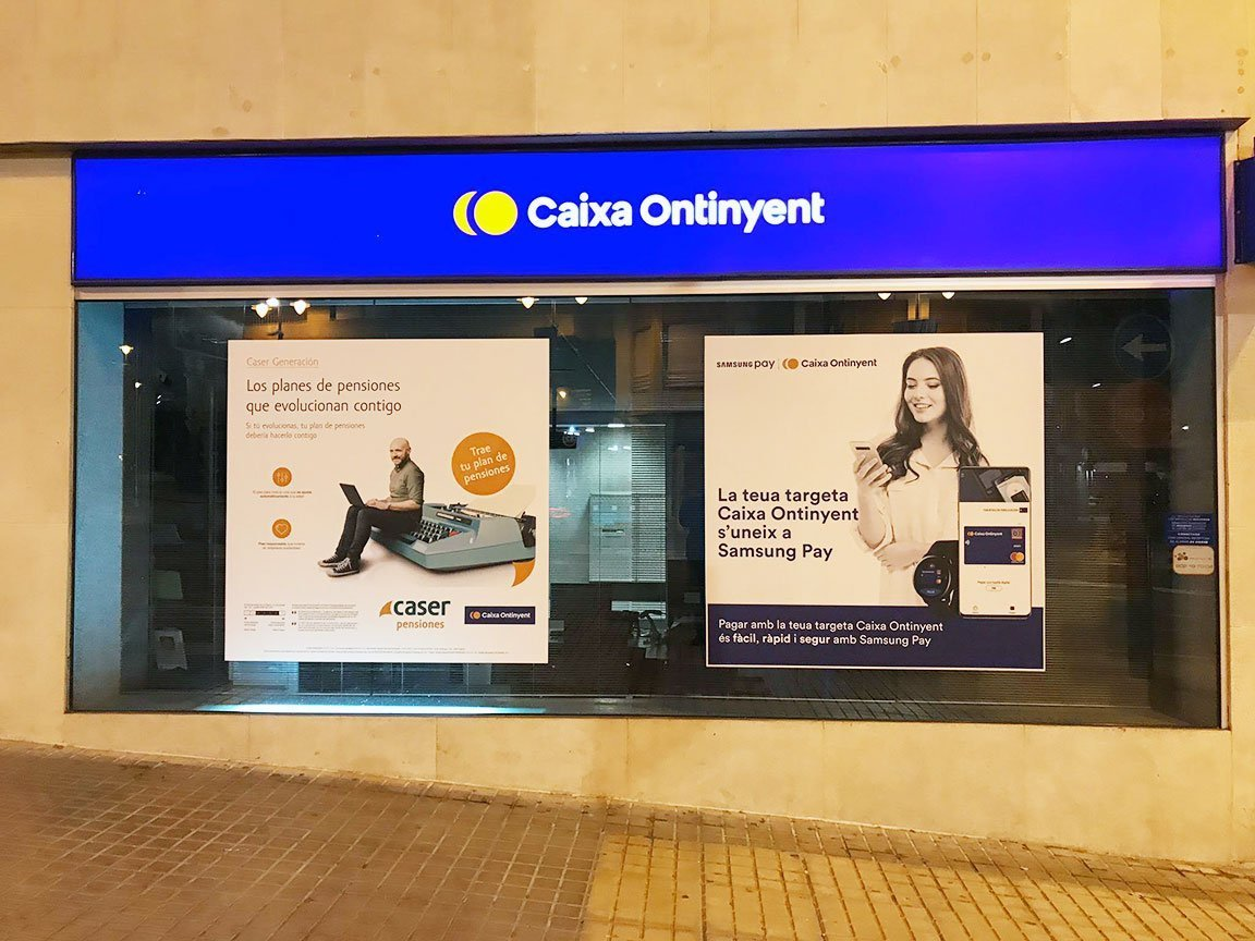 Bilingual marketing posters in Ontinyent, Spain