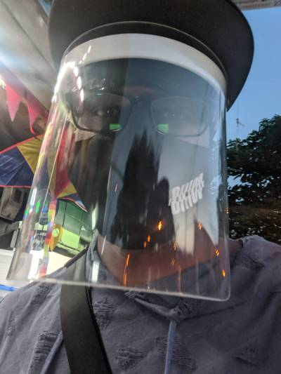 A picture of Lamon wearing a face shield and mask in Medellin, Colombia.