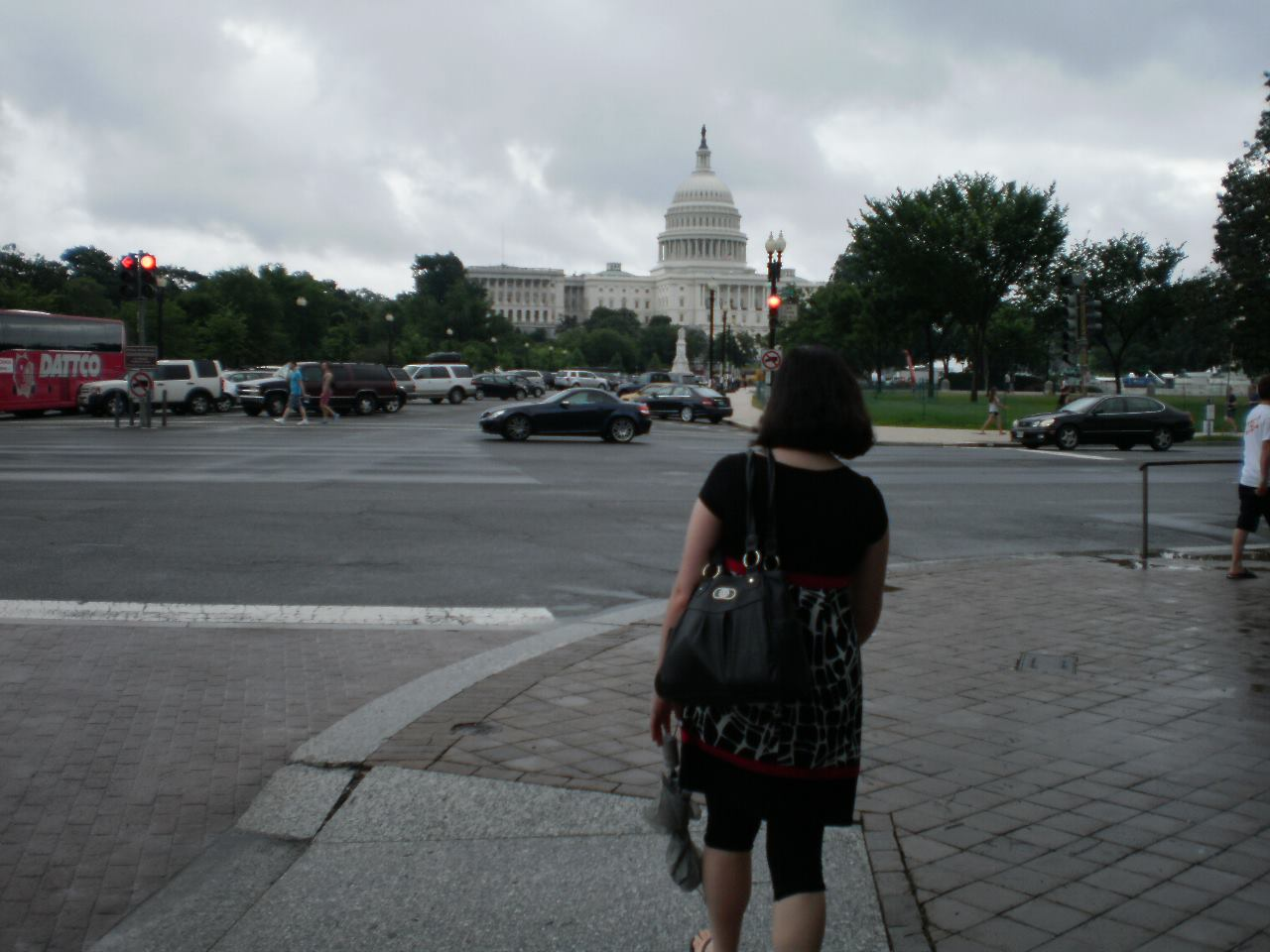 Sarah looking at the Capitol in Washington, D.C. while applying for her visa in Spain.
