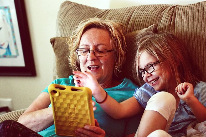 woman and girl using ipad