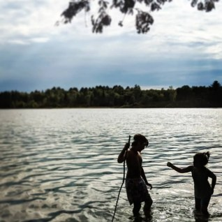 Dreams Built In, a Full Time RV Family, enjoying a lake in Minnesota