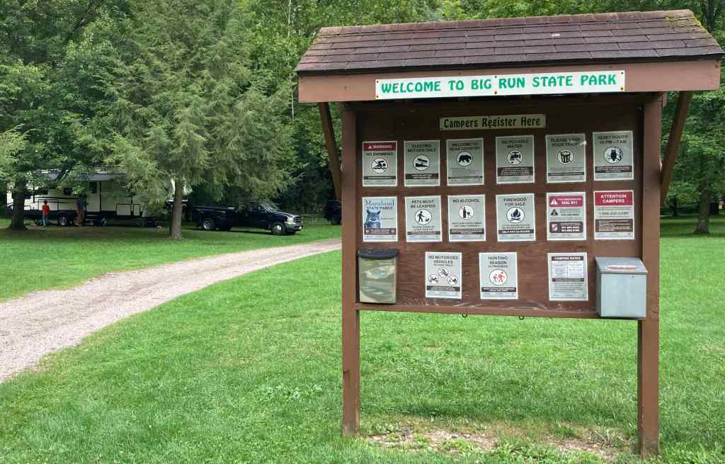 Big Run State Park Bulletin Board located at the state park entrance. The Dreams Built In's RV is shown parked on the left-hand side