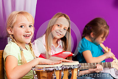 Stock Photography: Children making music with instruments at home. Image: 25531842