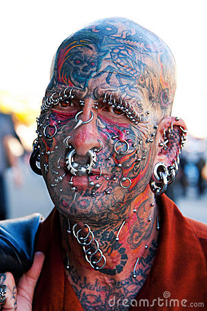 Editorial Image: Face with tattoos and piercings