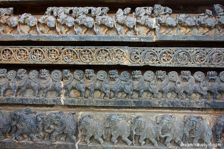 Lower carvings on the temple: elephants for strength, lyons for courage, flowers for beauty, horses for speed