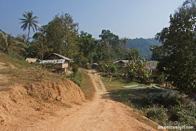 There is no sign, but this is Ba Na. From here, there is no more road to Huay Bo, we had to cross rice fields, a river, and then follow a small path