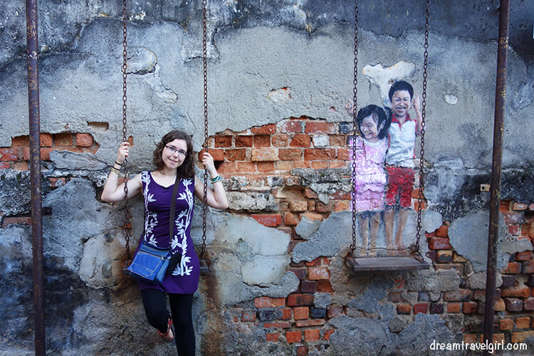 """Street art in Georgetown """"brother and sister on a swing"""""""