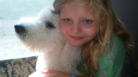9 year old Olivia and her Poodle Pele