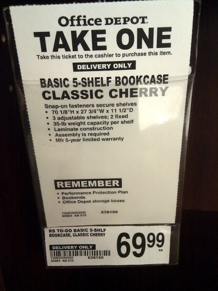 """The """"take one"""" slip for one of Office Depot's 5-shelf bookcases I use."""