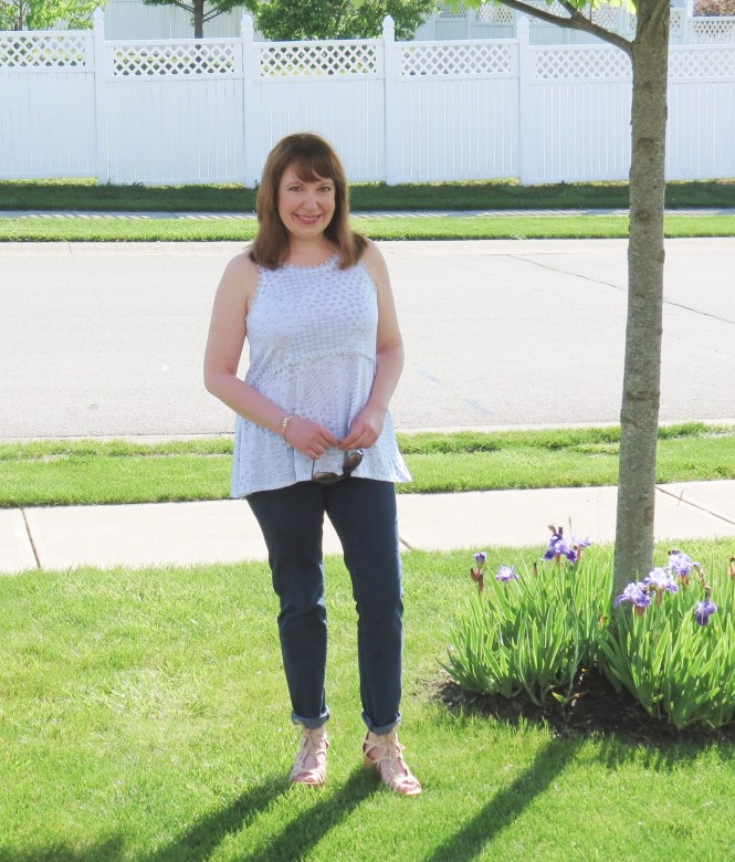Light Blue And White Sleeveless Top With Jeans