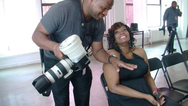 Photographer, Rick Jones and Gwen DeVoe have a candid moment during the Full Figured Fashion Week (FFFW) Social Media Workshop (2014)