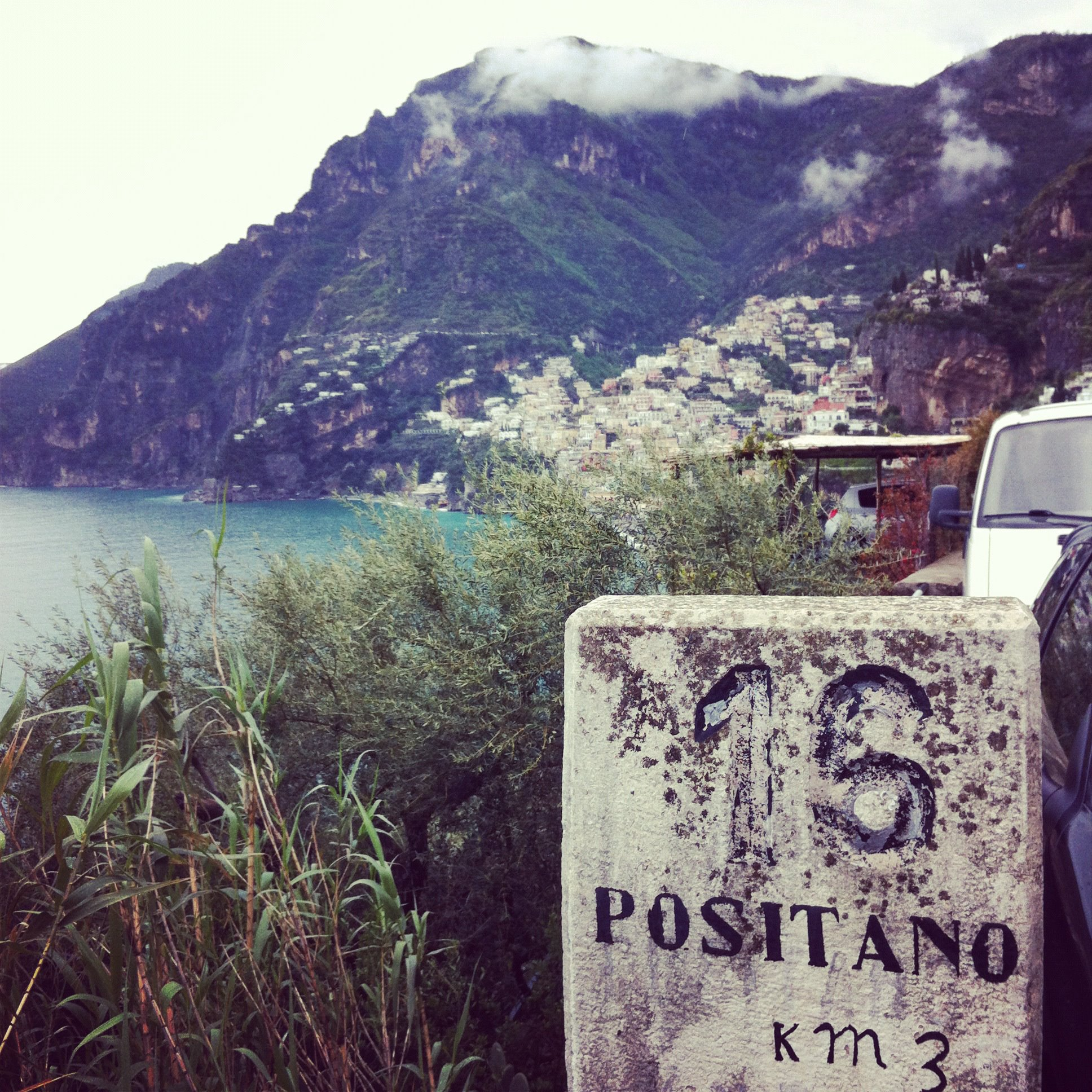 an old stone sign showing that Positano is only 15Km away..