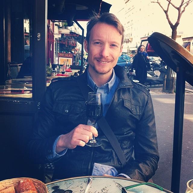 Travel writer Ben Holbrook sips on wine in Paris