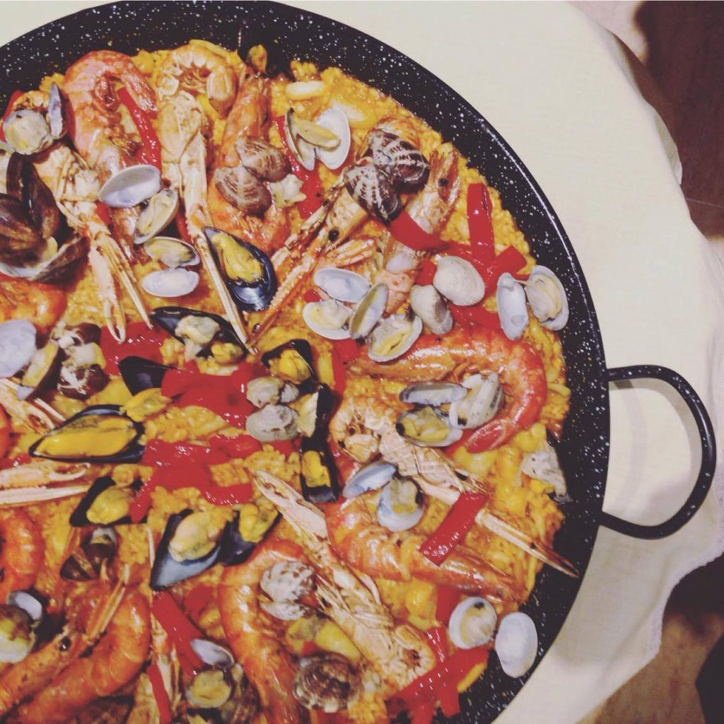 Eating home cooked paella at a chef's house in Barcelona
