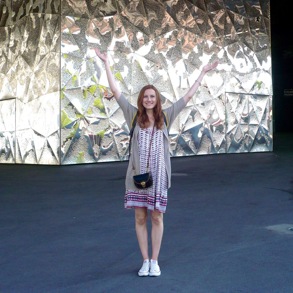 How to look like a tourist in Europe: wear a dress, and take pictures in front of shiny walls in this pose. Sometimes I just can't help myself.