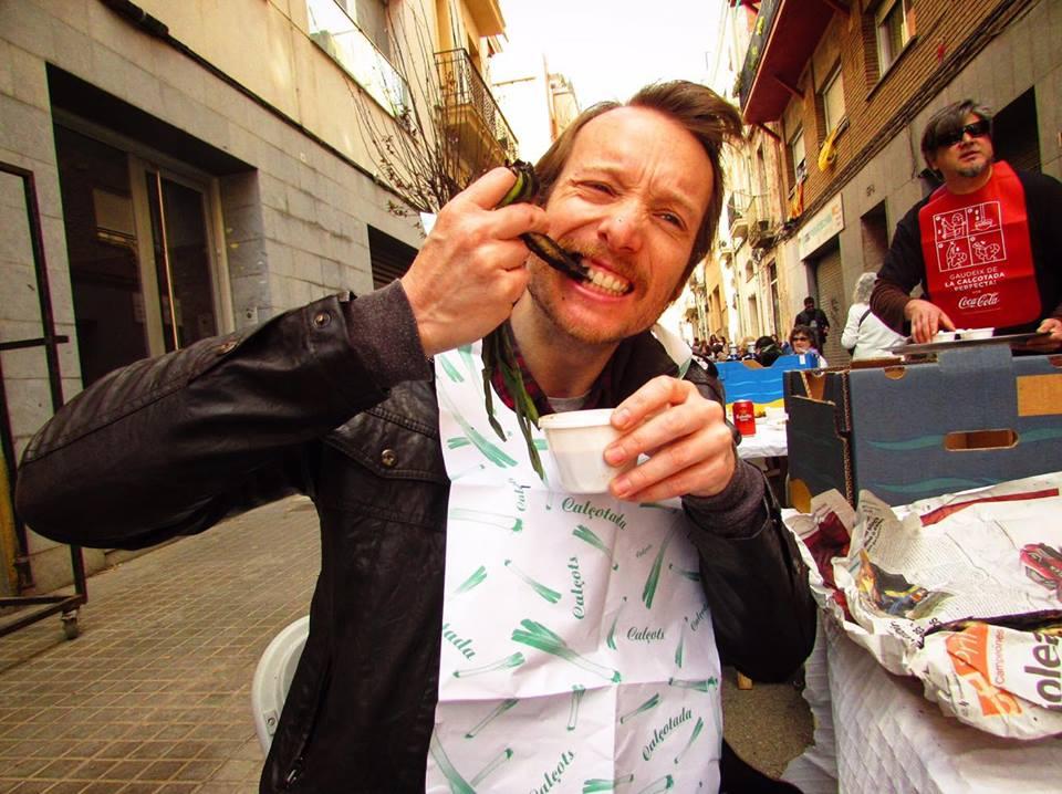 Travel & food writer Ben Holbrook eating calcots in Barcelona