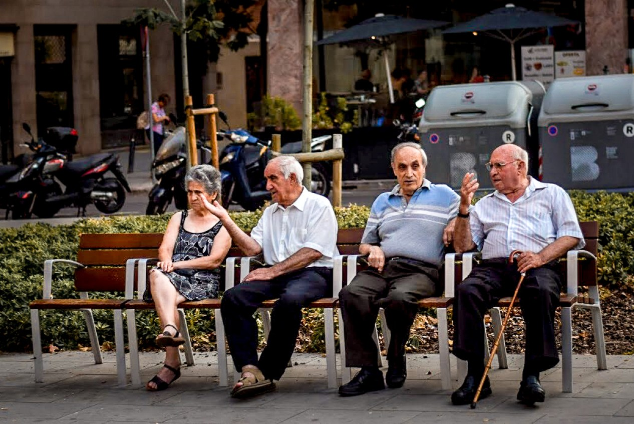 Elderly Spanish people talking ona bench in Sants, Barcelona
