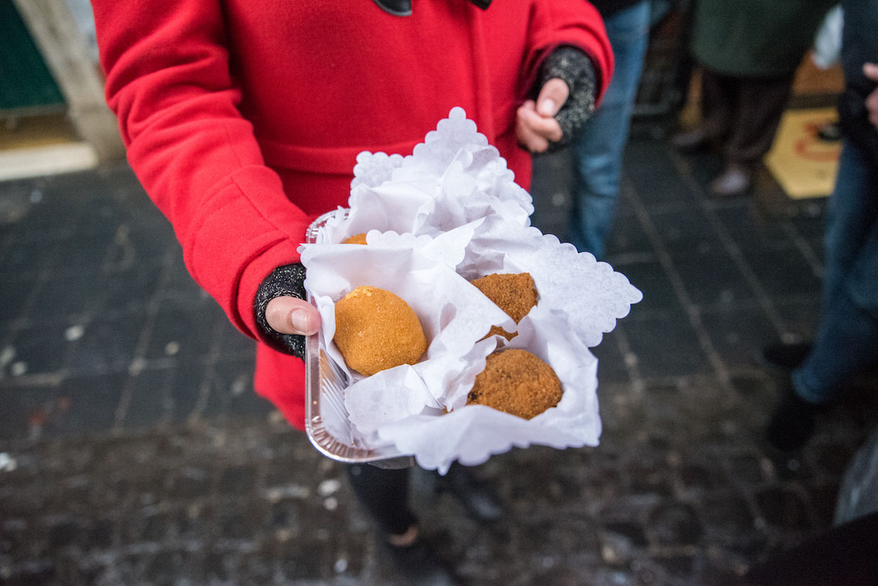 Eating suppli on Eating Italy's 'Trastevere for Foodies' food tour