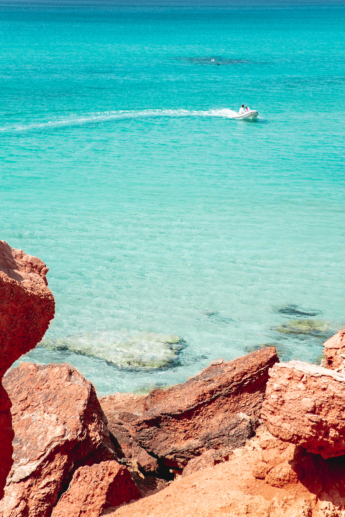 Turquoise waters and Mars-red rocks at Cala Saona, Formentera - Travel Guide by Ben Holbrook