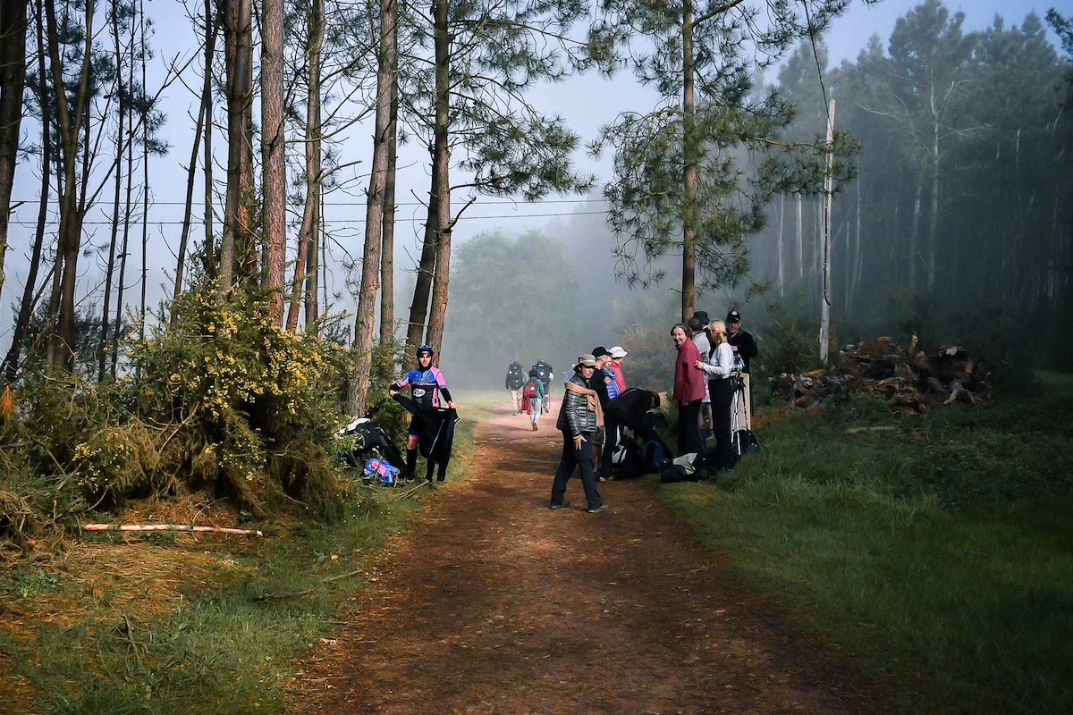 Temperatures rise dramatically once the fog burns off Camino de Santiago. Cyclists and hiker stop to remove layers.