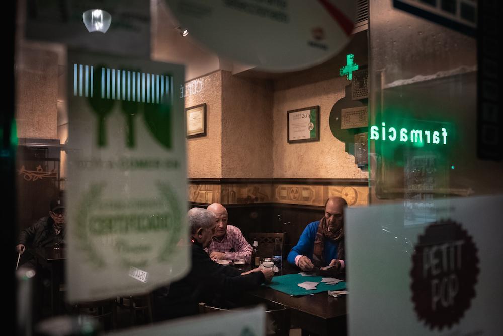 Asturian men playing cards in an old bar in Gijon.