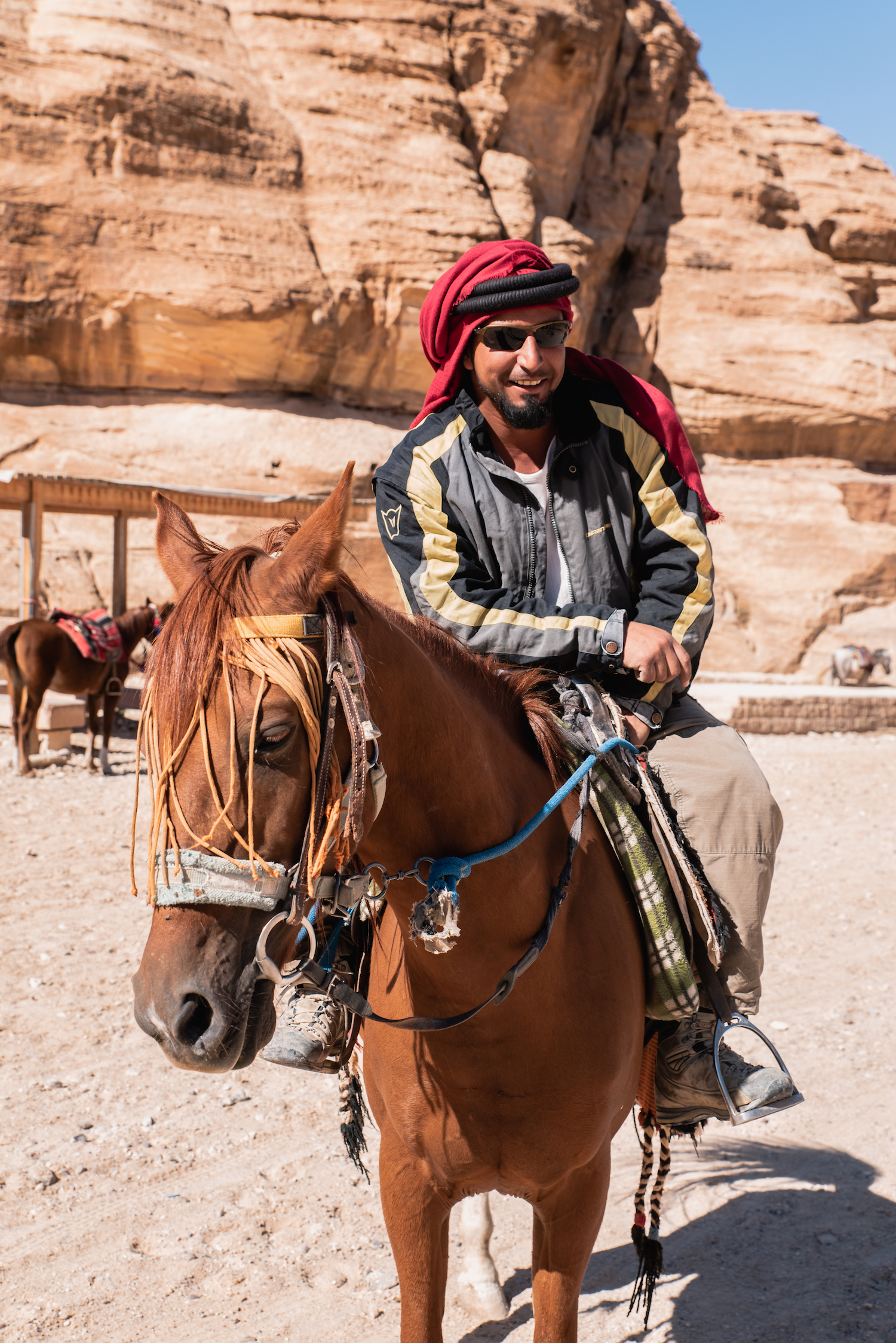"Susana and Muhammad scouting for customers to take to Petra. ""She's a beautiful horse, very strong. But the truth is that I have three horses. They can't be out for long when the sun is very hot."" - by Ben Holbrook from DriftwoodJournals.com"